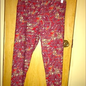 Red differently patterned leggings